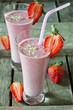Leinwandbild Motiv Strawberry smoothie on a wooden table