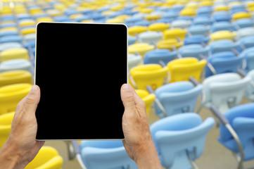 Hands Holding Tablet Football Stadium