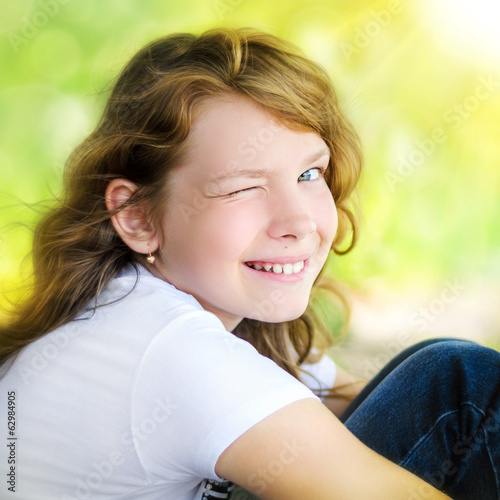 Portrait of a smiling cute little girl