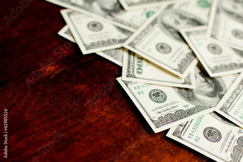 Background with money american hundred dollar bills on desk