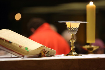 Chalice on the altar during the distribution of Holy Communion
