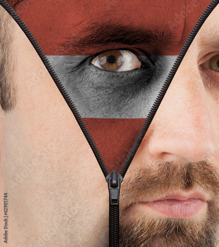 Unzipping face to flag of Austria
