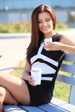 attractive young professional woman drinking coffee