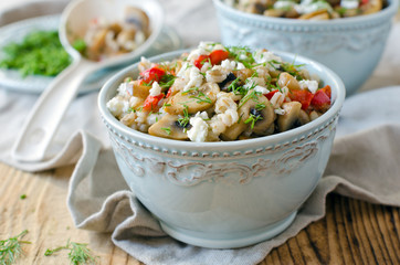 Barley porridge with mushrooms and vegetables