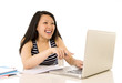happy chinese asian woman working pointing at laptop