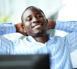 relaxed businessman looking away. african american businessman