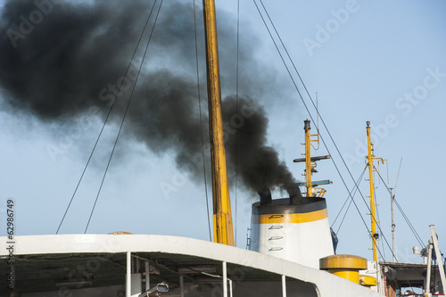 Exhaust smoke from a ship smoke stack