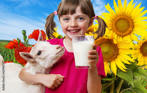 little girl drinking goat milk
