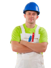 a men wearing working clothes with paint brushes in pocket and c