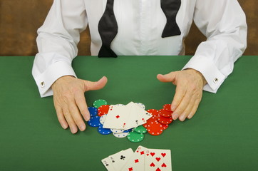 Image of Gambler with winning hand of Four Aces