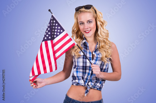 woman holding american flag on blue  background