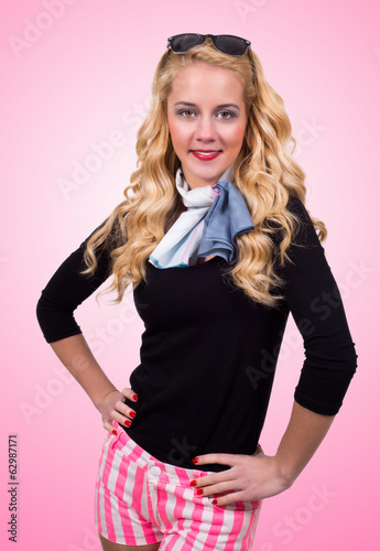 Caucasian retro blonde woman on pink background.
