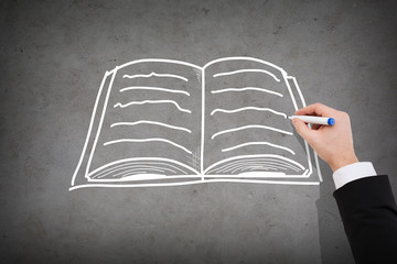 close up of businessman drawing book