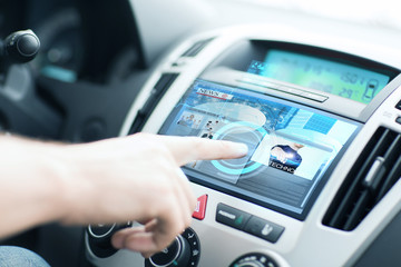 man using car control panel to read news