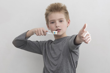 Boy likes to brush teeth a toothbrush