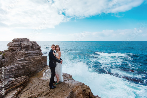 Bride and groom near the ocean