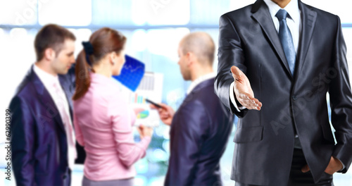 A businessman offering to shake your hand