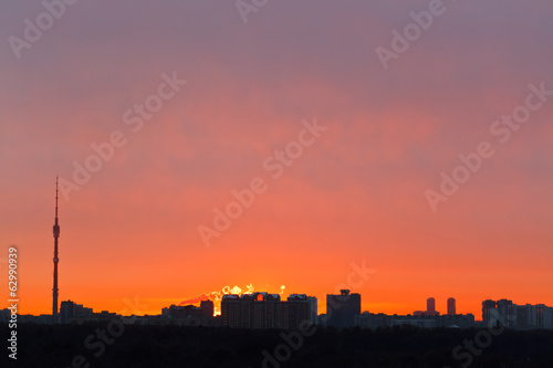 early red dawn over city