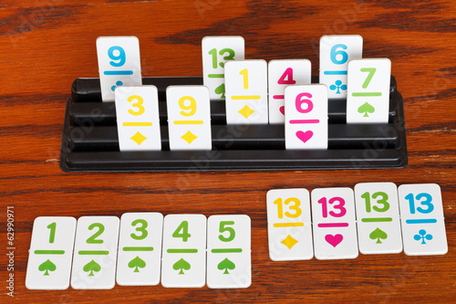 playing in rummy game - run and group of cards