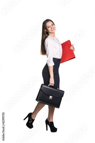 Portrait of a pretty business woman walking