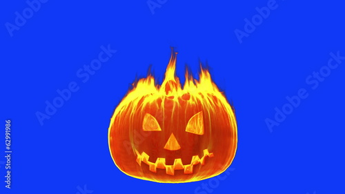 Halloween pumpkin gets on fire on blue screen