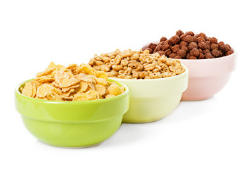 assortment dry cereal, flakes  for breakfast, isolated on white