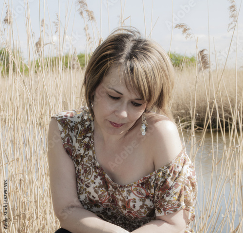 high key outdoor portrait of woman at side of lake