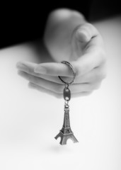 Female Hand Holding Souvenir of the Eiffel Tower. Studio Shot