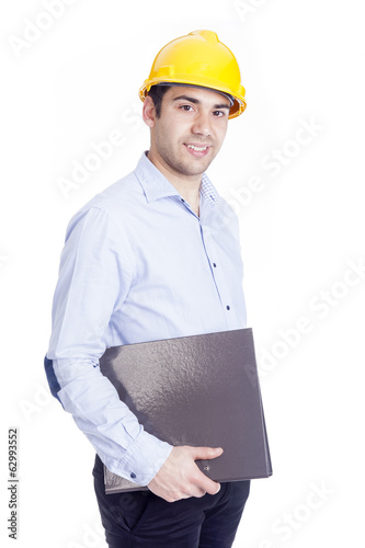 Portrait of a handsome engineer holding a folder, isolated on wh