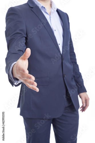 Business man with hand extended ready to handshake, isolated on
