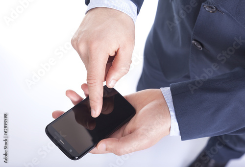 Businessman using a smart phone, isolated on white