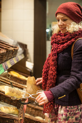 Young woman buying bread at bakery