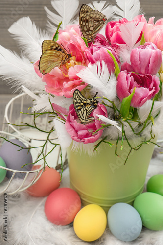 tulip flowers with butterflies and easter eggs