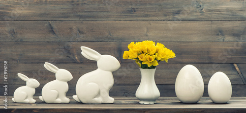 narcissus flowers with easter bunny and eggs