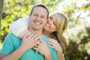 Young Attractive Couple Hugging in the Park