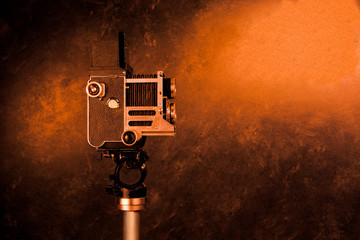 Old vintage camera on a tripod