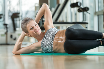 Smiling Woman Doing Abdominal Excerise