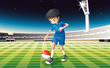 A boy at the field using the ball with the flag of Singapore