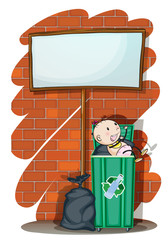 A baby inside the trashcan below an empty signboard
