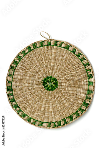Close up view of a wicker plate isolated on a white background.