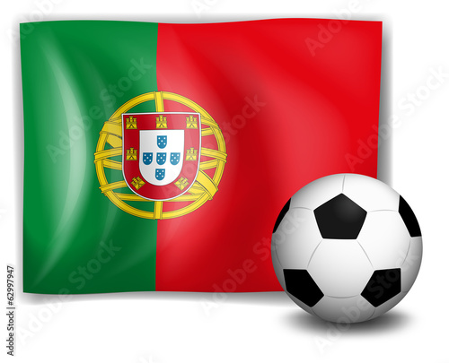 A soccer ball in front of the Portugal flag