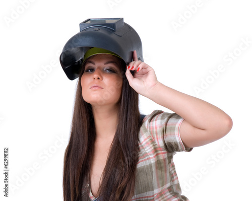 Young woman in welding mask.