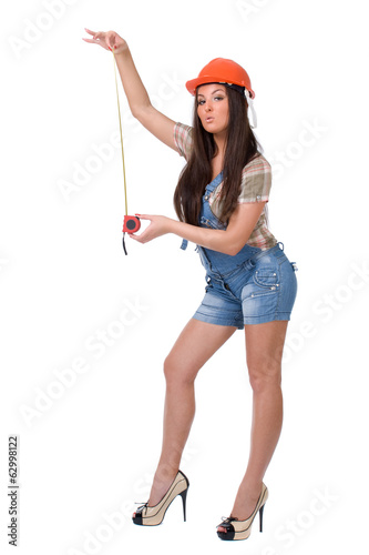 Young woman holding tape measure tool. Over white background.