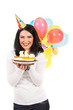 Laughing woman with birthday cake