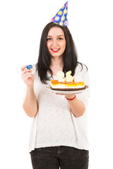 Cheerful woman with birthday cake