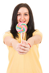Happy woman offering lollipop