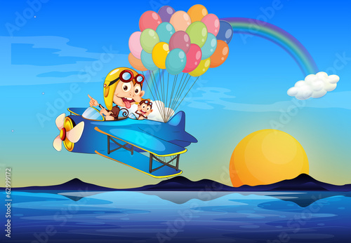 A plane with monkeys and balloons