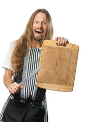 Surprised hippie chef pointing knife to chopping board