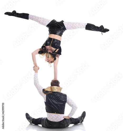 Young acrobats posing in costumes for performances
