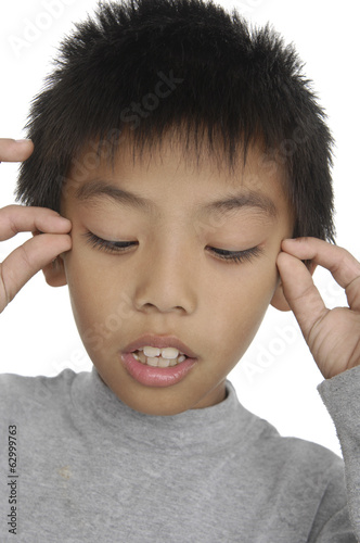 Surprised little kid covering his eyes on white background